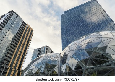 Looking up at the Amazon world headquarters campus condominium and office towers featuring the Spheres located in downtown Seattle taken late afternoon under overcast sky circa October 2017.