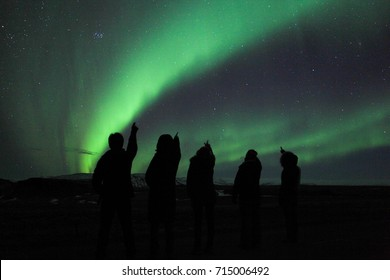 Looking at Aurora borealis in Iceland  / Iceland