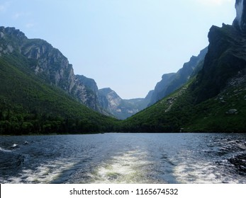 Looking back from the tour boat at the end of the fjord of the Western brook pond in Gros Morne National Park, Newfoundland and Labrador, Canada