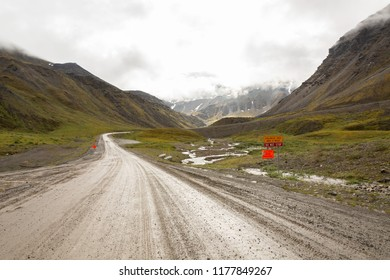Looking back towards Antigun Pass on a stormy and wet summer day from the Antigun Valley on the remote Dalton Highway, Alaska.