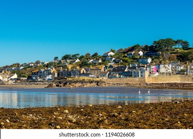 Looking back at the village of Marazion from the beach at low tide