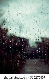 Looking at the beautiful rain drops out side the window abstract art background. Vintage Tone