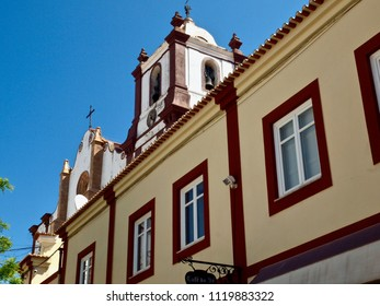 Looking up to the bell tower of the church of silves in Portugal