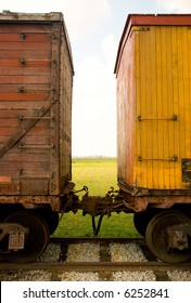 Looking between two old train cars
