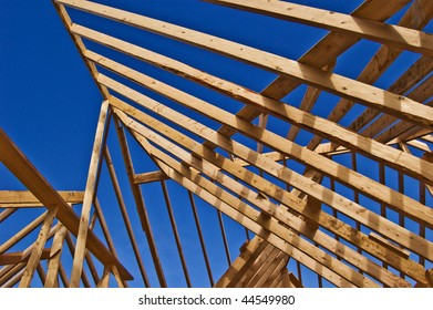 Looking at the blue sky through roof construction of a new home