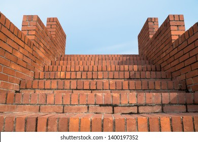 Looking up to the brick stairs.
