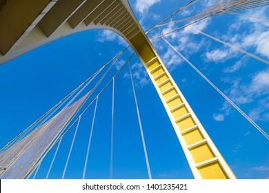 looking up bridge in sky
