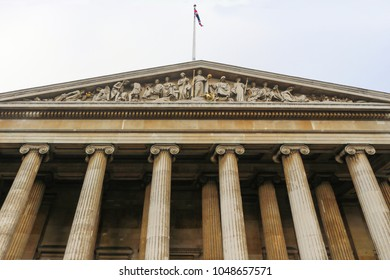 Looking up at the British Museum, built in Greek Revival style and featuring a pedimental sculpture emphasizing the education of mankind located in the Bloomsbury area of London United Kingdom 1 10 20