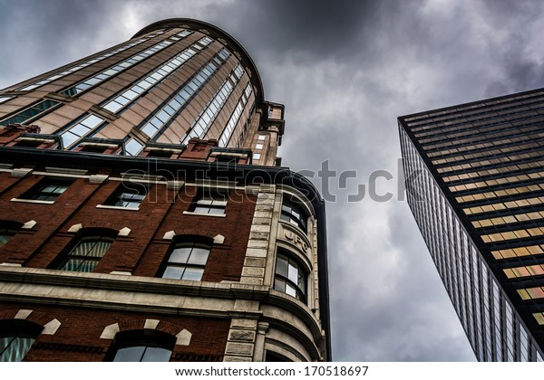Looking up at buildings and a cloudy sky in Boston, Massachusetts.