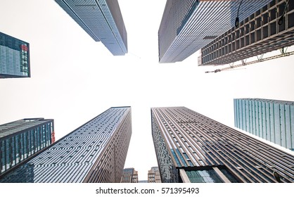 Looking up at business buildings