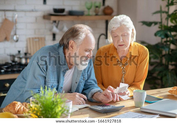 Looking busy. married couple making calculations together and looking involved