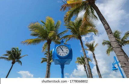 Looking up at the clock in Times Square.  Times Square is considered the heart of Estero Island with shops, restaurants and the Fort Myers Beach Pier in Fort Myers Beach, Florida, USA.