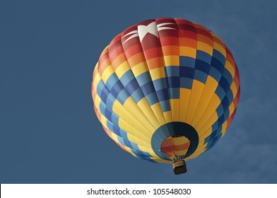 Looking up at colorful hot air balloon, nice blue sky