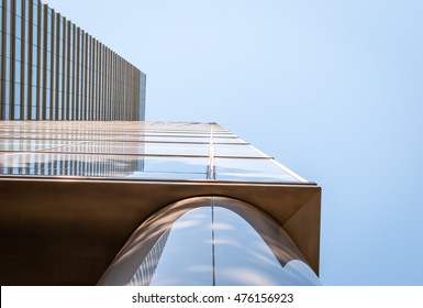 Looking up corner of modern building. Office building exterior with reflection. Minimal architecture on city street. Black and white abstract color design.