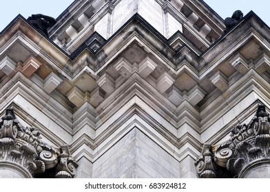 Looking up at the corner of the Reichstag building with decorative elements. Berlin, Germany. Architectural composition.