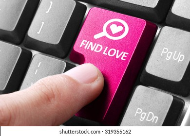 looking for a couple. gesture of finger pressing find love button on a computer keyboard
