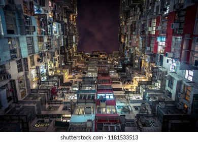 Looking up at dense living conditions of apartments in the Hong Kong