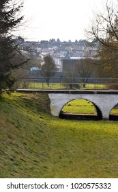 Looking at a Ditch and a Bridge, City in the Background, Giengen/Brenz, Swabian Alb, Germany, Europe