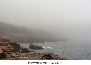 Looking down the Acadia National Park Shoreline on a foggy morning in Maine, New England