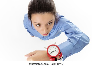 looking down at a business woman wearing a large wrist watch looking like she running late