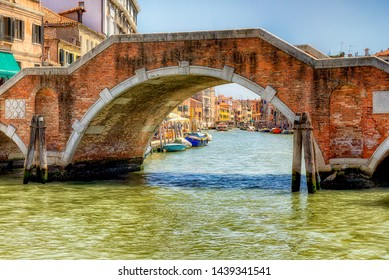 Looking down the canal through the Ponte dei Tre Archi in Venice