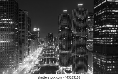 Looking down the Chicago River at night in Chicago, Illinois in black and white.