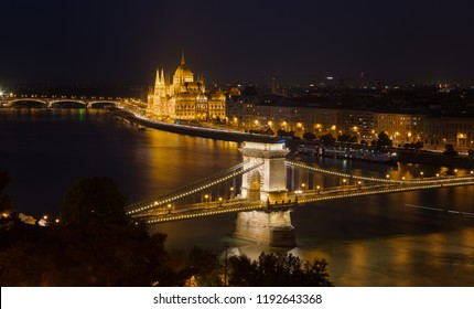 Looking down to the Danube river with parliament building and chain bridge in Budapest, Hungary