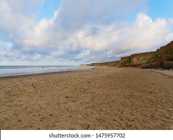 Looking down a deserted Happisburgh beach on a summer evening