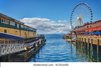 Looking Down the Docks of the Pier District in Seattle, Washington with the Great Wheel in the Distance