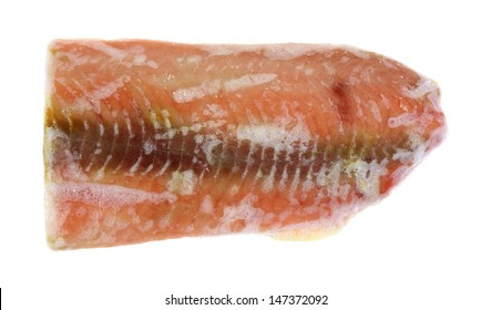 Looking down at a frozen salmon steak.