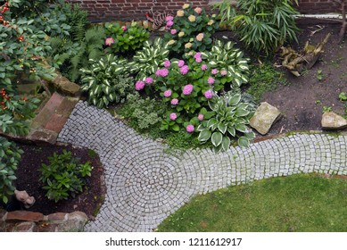 Looking down to a garden with brick path
