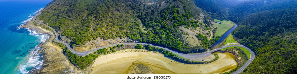 Looking down at Great Ocean Road bends along the coastline near Lorne, Australia