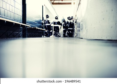 Looking down the hall way with hockey players.