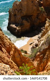 Looking down to hardly reachable beach. Portugal.Algarve.Often used by nudists for sunbatching.