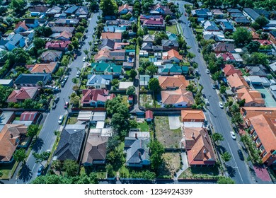 Looking down at houses in typical Australian suburb - aerial view