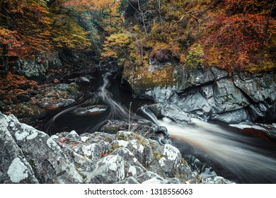 Looking down into cascades of Fairy Glen Gorge waterfall at autumn in Snowdonia National Park in North Wales, UK