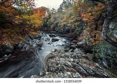 Looking down into rocky cascades of Fairy Glen Gorge waterfall at autumn in Snowdonia National Park in North Wales, UK