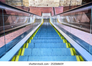 Looking down at multiple escalators outside building