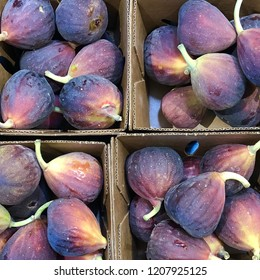 Looking down on four boxes of fresh figs
