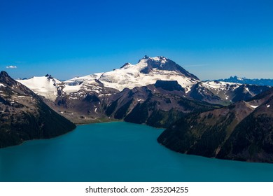 Looking down on Garibaldi Lake on a clear day, in British Columbia, Canada, with Mount Garibaldi rising high in the background.