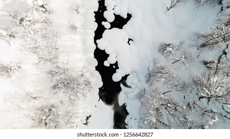 Looking down on a snowy river