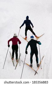 Looking down on three cross country skiers.
