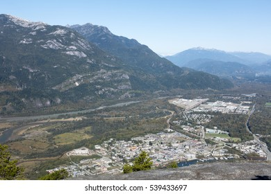 Looking down on the town of Squamish, British Columbia, Canada from the summit of the Stawamus Chief