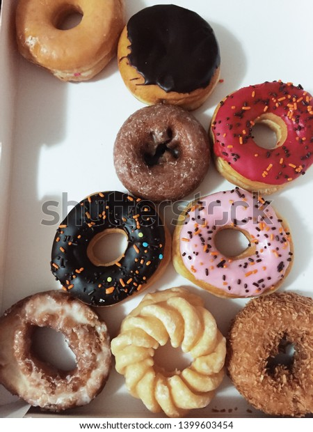 Looking down on a variety of yummy donuts