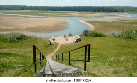Looking down a set of stairs towards the Glenmore Reservoir in Calgary, Alberta