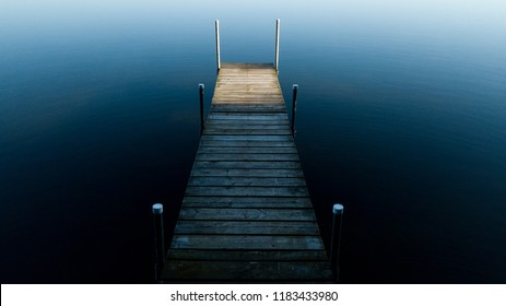 Looking down at a shaded dock in the water