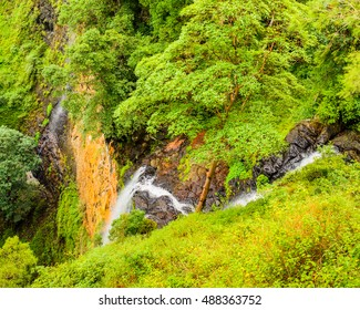 Looking down the sheer drop of Mapleton Falls in the Sunshine Coast hinterland in Queensland, Australia