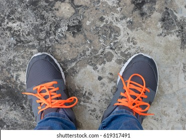 looking down in sports shoes on concrete