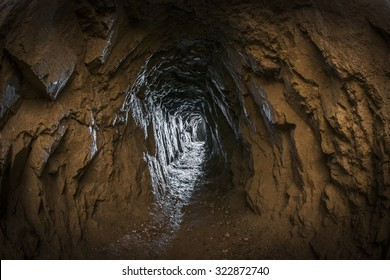 Looking down the tunnel of a hard rock mine.