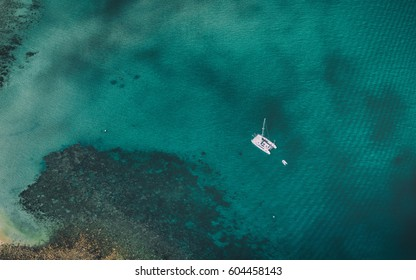 Looking down upon a boat float in shallow water